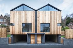 Adam Knibb's twin wooden homes seem to hover above the ground!