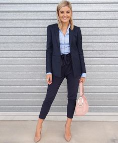 I have a pair of high-waisted paper bag pants and love them, though have a hard time pairing with shirts so I don't look like I just pulled my pants up too high. I like this look and that these ones are more fitted at calf.