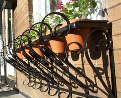outdoor wall planters wrought iron