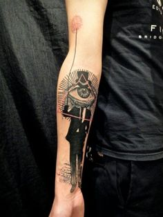 New style men with seeing eye forearm tattoo