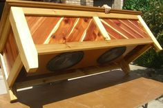 Outdoor Cedar Subwoofer Bench...  Really?  Someone needs to annoy their neighbors with a sub woofer outdoors?