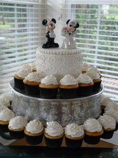 The best of both worlds!  A combination of cupcakes and a cutting cake at an intimate wedding ceremony.  Cake by Baker @Lisa Dorn.