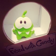 Most pets hate being stuck inside, but, not Om Nom… at least as long as there is plenty of candy in sight! Thanks Venessa for posting this sweet clay sculpture! Like this picture if you plan to feed Om Nom with candy today! * iPhone or iPod touch: http://itunes.apple.com/app/id608899141 * iPad:  http://itunes.apple.com/app/id608901634 * Google Play: http://play.google.com/store/apps/details?id=com.zeptolab.timetravel.paid.google #cuttherope #time #travel #omnom #cute #green #little #monster…