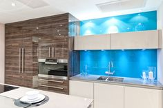Japanese Pear with cream gloss kitchen and coloured back-splash