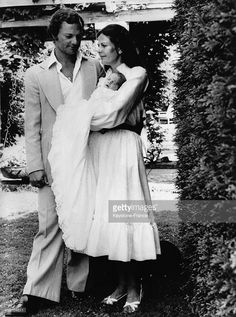 King Carl Gustaf of Sweden and his wife Queen Silvia present their first daughter Princess Victoria to the press in August 1977 in Solliden, Sweden.