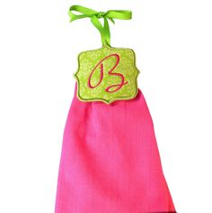 Not Your Granny's Towel Topper - Add Whimsy and Delight to your kitchen with our monogrammed towel toppers. The modern shape and pretty alphabet gives you a fresh take on an old fashioned idea! Design contains all 26 letters of the alphabet. The attached ribbons allow you to attach a towel to your oven or refrigerator handle and prevent it from falling off! The towel attaches to the topper with a strip of elastic that is stitched in during the design process. Make beautiful and functiona…
