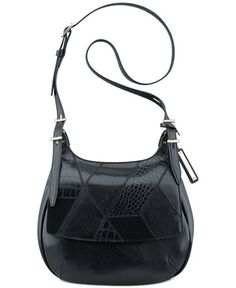 A fresh take on ladylike, Nine West's saddle bag features a timeless silhouette…
