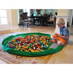 Lego activity mat. Contains legos in one space and then use the drawstring to close the mat up into a bag. Genius!!