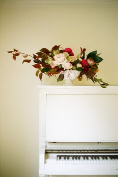 Dress up a mantel or a piano top with a beautiful floral arrangement | As seen on SMP Living: http://www.stylemepretty.com/living/2013/11/20/thanksgiving-ideas-decor
