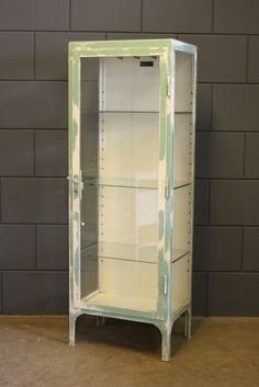 Best of the Past- Industrial Vintage metal medical cabinet, with salvaged mint green original paint. This is a one of kind find, love the colors!