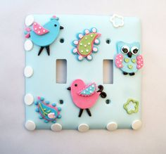 This switch cover features two cute birds in pink and turquoise with a sweet little owl. A touch of paisley and polka dots adds to the fun - by Thimbletowne on Etsy.