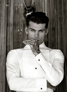 Hand tattoos. I bet he has more under that shirt