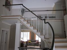 Over the post two toned hardwood stairs