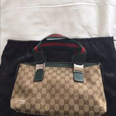 Gucci GG logo handbag Gucci Tan/brown GG logo handbag.  No visible wear.  Dust bag kept.  Green leather detail.  Gucci logo horse-bit detail hardware.  Comes with dust bag.  Dimensions- 13 x 7 x 4 Gucci Bags