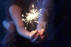 Sparklers in the hands of the coupl by NikSorl on Creative Market