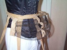 """This bustle dates to about 1887-1889, but continued in a slightly smaller size until about 1911. It is made out of criss-crossed wire, which was thought to allow your back to """"breathe"""", thereby eliminating fainting.  Ironically, they were worn by themselves in the 1890's to Edwardian times to give the skirt a slight rise in the back and to stop the skirt from sticking in between your bum."""