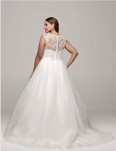 "<a href=""http://www.davidsbridal.com/Product_cap-sleeve-tulle-ball-gown-with-illusion-neckline-9wg3672_wedding-dresses-plus-size-dresses"" target=""_blank"">Cap Sleeve Tulle Ball Gown with Illusion Neckline</a>, David's Bridal"