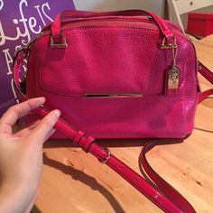 """Coach SML Georgie satchel Pre-loved soft pebble leather Coach satchel (small """"Georgie"""") bag in """"Pink Ruby"""" color. Gold hardware. Small signs of wear on hardware and worn a little on each corner where purse naturally sits, can only see when looking at bottom of bag. Tan satin lining with minor signs of use. Still gorgeous and gets me compliments any time I wear!!!  Adjustable strap and dust bag included!  Coach Bags Satchels"""
