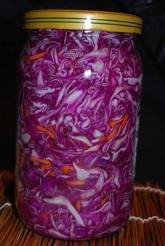 Pickled Cabbage 1 med. size head red cabbage 2 large carrots Boil 2 c. water, 6 tbs sugar, 2 tbs salt 1/2 cup white wine or rice vinegar Do not add 1/3 c. olive oil to layer it in, later. Put cabbage in 2-3 qt. glass jars in layers: first fill 1/4 of the jar, push cabbage tight & pour 1/4 of the marinade & 1/4 oil. Add another 1/4 of cabbage & carrot mix, push it down & add 1/4 of the marinade & 1/4 of oil again. Repeat 2 more times until the jar is full.