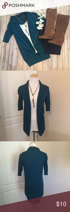 """Express teal short sleeved cardigan/shrug This lightweight cardigan is the perfect transitional piece to cooler weather, yet can be worn immediately. Pair it with some leggings and boots and you're set for casual Friday or happy hour with the girls! It is super comfy. 33""""long, 100% cotton. There are 2 very small holes/snags that are not unraveling and are only noticeable upon close inspection. One at right arm seam and one under back collar. Express Sweaters Cardigans"""
