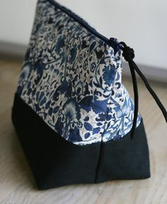 """Liberty of London Lodden Blue and Organic Cotton Color Blocked Zipper Pouch, in blues, black and grey. Approximately 10"""" wide x 6"""" tall. William Morris fabric design."""