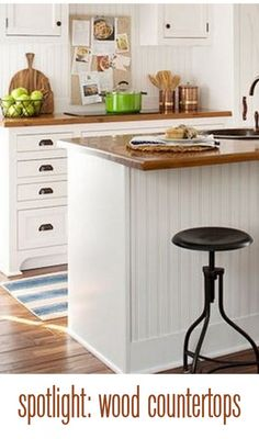 Love the look here -- stools, hardware, beadboard, kickstop details. Like the wood counters but would prefer thicker