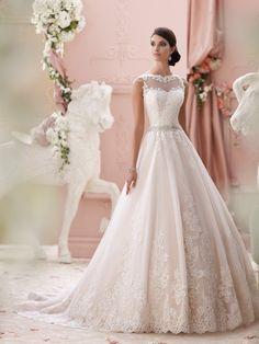 Style 115244, Seraphina is an elegant illusion neckline wedding dress designed by David Tutera for Mon Cheri. Click for more information on this style.