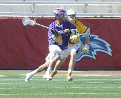 Lyle Thompson of UAlbany makes an offensive move in the America East title game against University of Maryland Baltimore County at Stony Brooks stadium