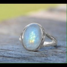 Stunning .925 SS Rainbow Moonstone Ring Sterling silver split band design ring with oval moonstone. The moonstone is approximately 15.5mm x 12mm. This ring is available in whole sizes 5-11. Jewelry Rings