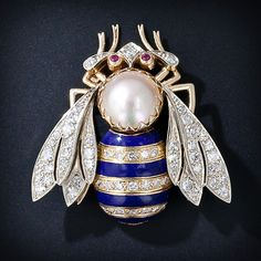 Diamond and Enamel Bee Pin -  her abdomen is striped in cobalt blue enamel and its head shimmers with a round Mabe pearl and ruby eyes.