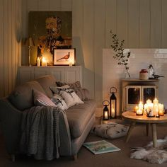 Hygge home decorating idea. Cozy living room with round small coffee table and ivory sofa