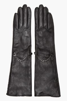 Long leather gloves with chains.