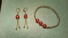 Orange Pearls, rhinestones, gold metallic beads, stretch bracelet and dangle earrings with leverback wires