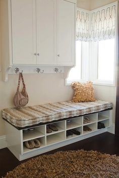 Alice Lane Home: Chic mudroom design with white cabinets, white bench with white & beige striped cushion, ...