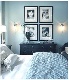 Blue Bedroom Walls W/black Frames And Furniture.