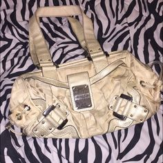 Guess beige purse Great condition, barely used. Only flaw is on the bottom of the bag as pictured. Guess Bags