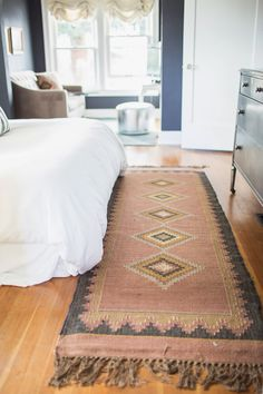 Santa Fe rug. Loved the muted colors. Pairs perfectly with the bright white bedding #rug #decor #bedroom