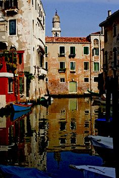 Walking along the canals of Venice we found this reflective shot with a leaning bell tower in the background.