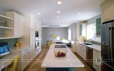 Transitional kitchen with classic white cabinetry and glass tile backsplash. Microwave drawer and espresso machine.