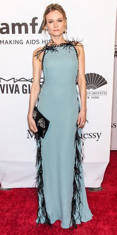 Diane Kruger stunned at the 2015 amfAR New York Gala in a pale blue Prada creation lined with black feather accents. An embellished clutch and Harry Winston diamonds completed her look.