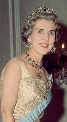 Queen ingrid of denmark wearing an Emerald Parure (part of the Crown Jewels).