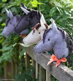 Make these for kid's favors at a birthday party? Stuffed felt heads on cut/sanded dowels?