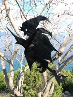 Salem Witch handmade and hand painted figure - Wood unique Black silhouette design - Home decor - Wall, tree hanging - Witchcraft  Product details  - Hand cut plywood and hand painted - Hook from cooper - Vivid colors on both sides - Unique design  Product Dimensions  33cm Width x 58cm Height x 0.5cm Thickness by Think4HandmadeArt, €30.00