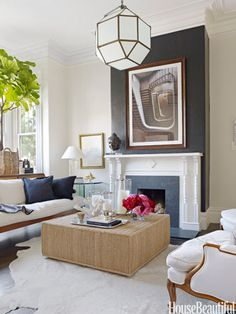 """Antique meets modern in the living room of a San Francisco Victorian designed by Ken Fulk. He chose a black-and-white palette, softened with neutrals and natural textures. The chimney breast, which is papered in Ralph Lauren's black Yacare Crocodile, adds sex appeal. """"It looks great, that texture, and it's fun,"""" Fulk says."""