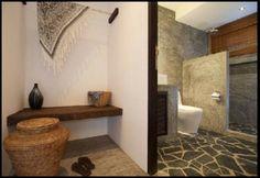 diseño de baño con suelo de piedra