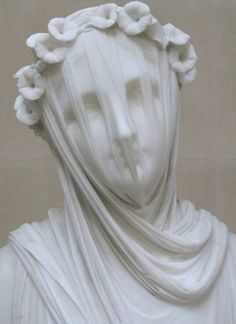This marble seems as if it really is transparent.  A Veiled Vestal Virgin, Raffaelle Monti., Chatsworth house...