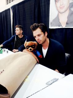 """Sebastian seems to be saying to the Teddy Bear Captain America:        """" Look : I have a lot more fans than you !"""""""