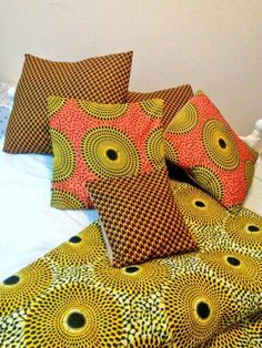 x2 Large Holland Wax print cushions x2 Medium African wax print vs sued cushions x1 Small Holland Wax print vs faux sued Cushion African Print contrasted with a crotchet style knitted blanket = The Cosy Throw