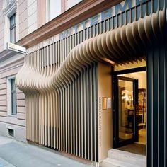 "salon mittermeier hair salon in linz by austrian architects xarchitekten features a facade with a ""three-dimensional architectural (hair) wave""."