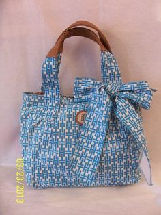 Tommy Hilfiger Tote Style 6919885 333  Color Blue     Retail Price $ 98.00     Brand New with Tags    Check my ebay store for more Tommy hilfiger bags: http://stores.shop.ebay.com/TopDesignersJeans4U